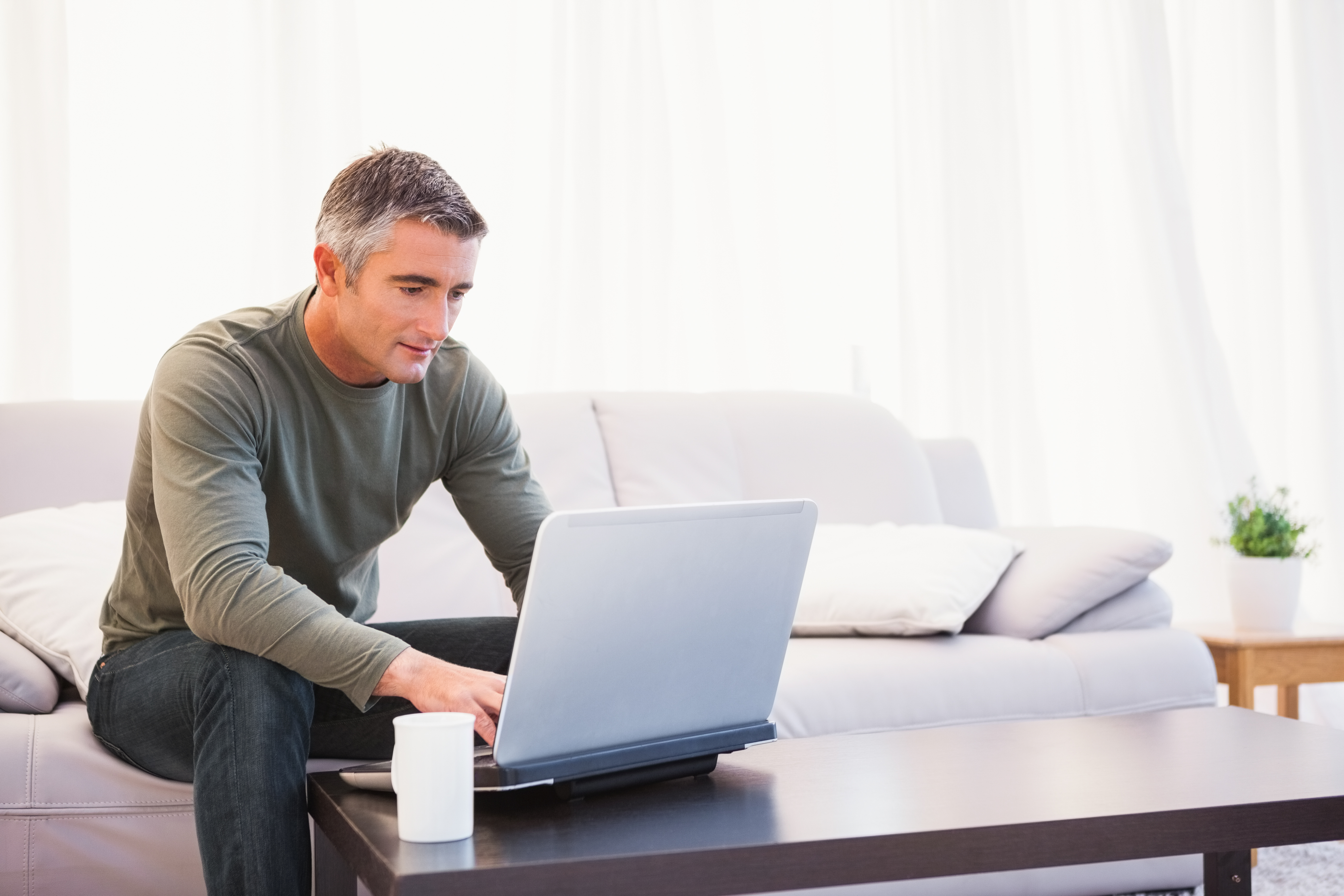 Man using laptop to learn about the U.Plan and U>Fund
