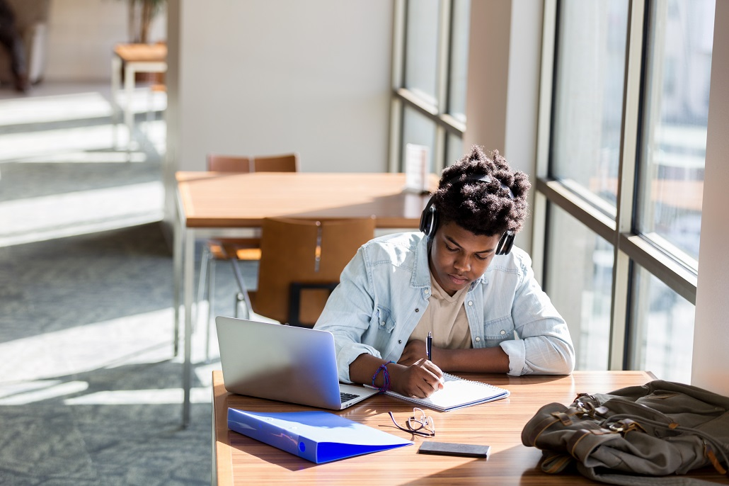 Student using laptop to learn about scholarships for minority students