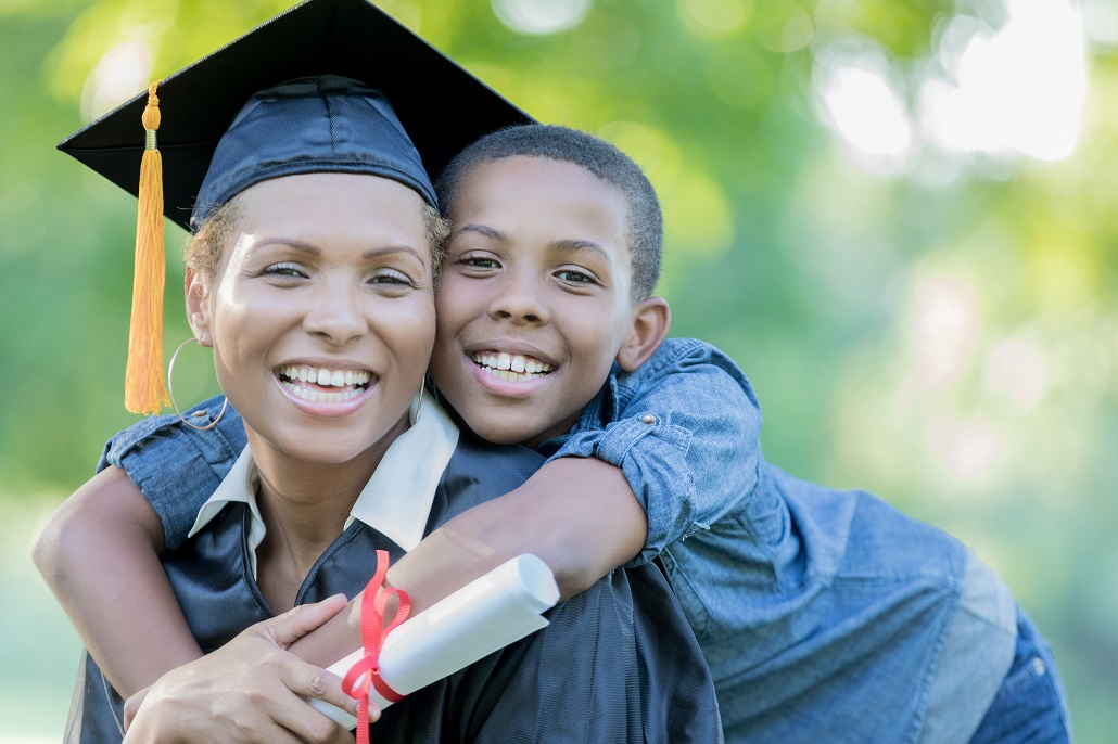 Woman graduating college after receiving scholarship for adult learner