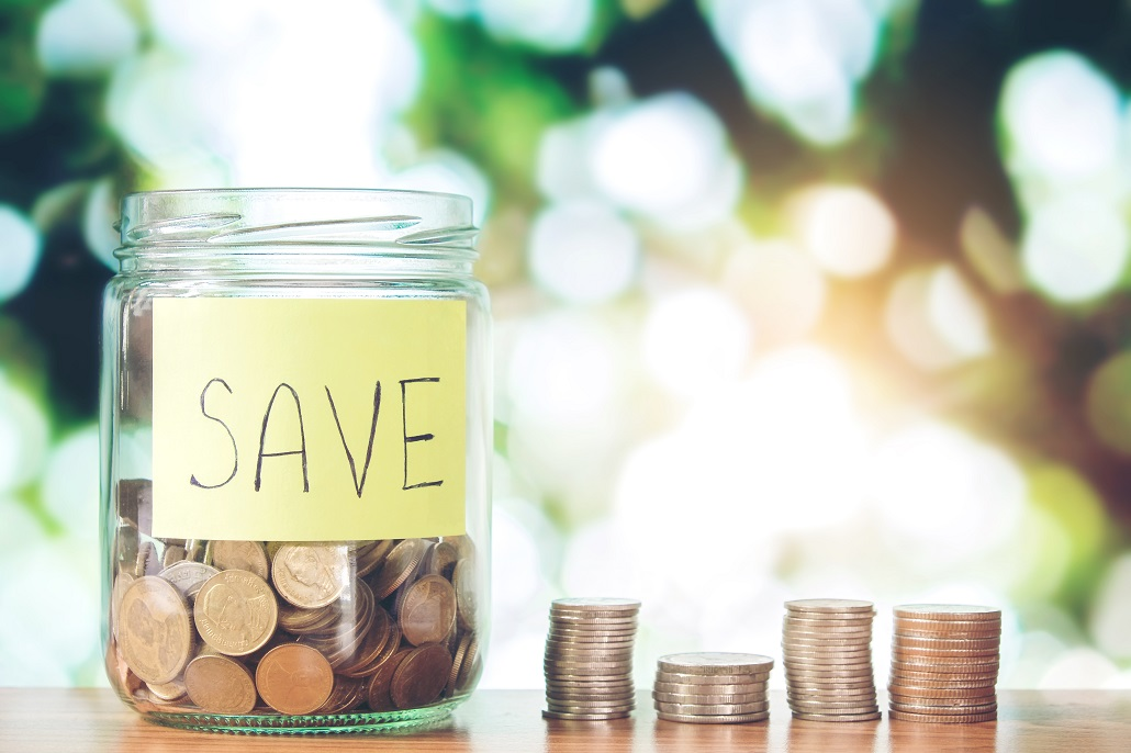 Jar of coins for Back to School College Savings