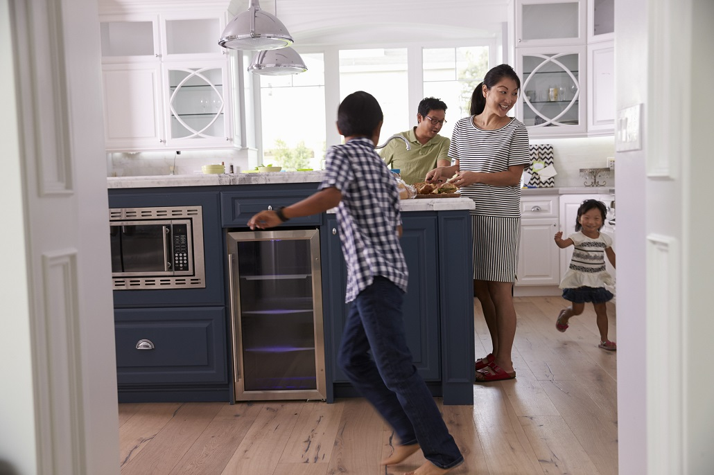 Family in kitchen saving money for college