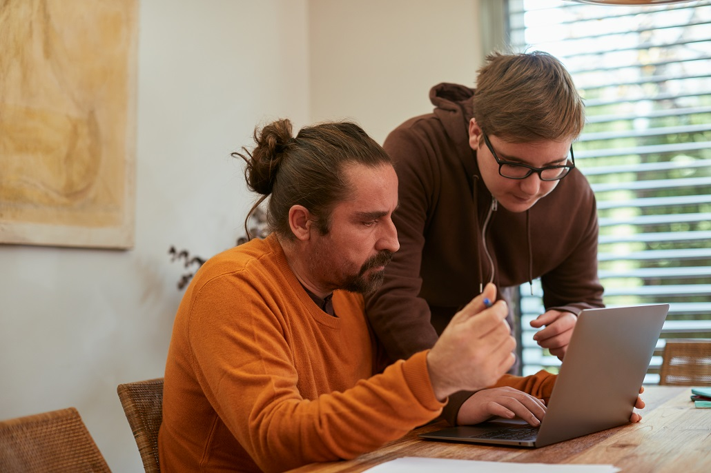 father and son using computer to get answers to questions about student loans