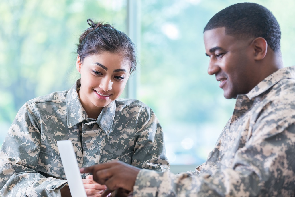 Veterans using laptop tp learn about education benefits