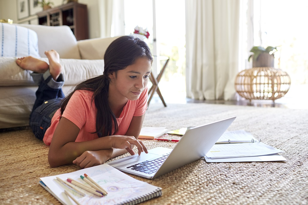 Student using laptop in off campus housing