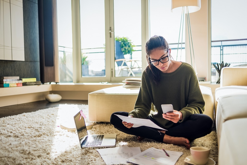 Woman fitting student loan payments into financial plans