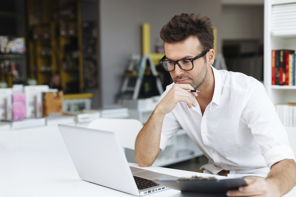 Man using laptop to learn about Adjusted Gross Income