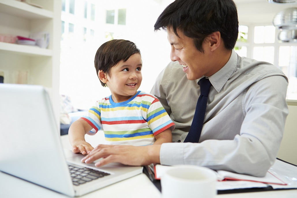 Father and son learning about Tax-Deferred College Savings Plans