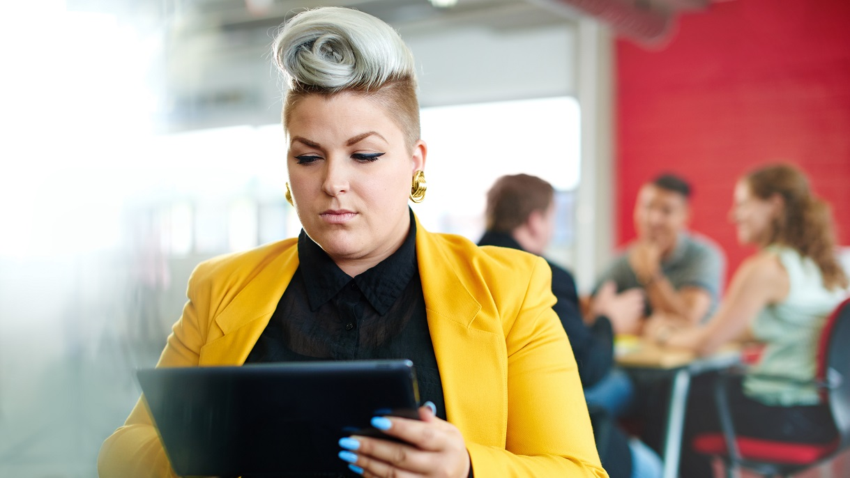Woman using tablet to learn about NPEA