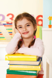 Young girl with best books for preschoolers
