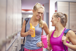 Two female college students in locker room