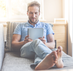 Man using tablet on couch