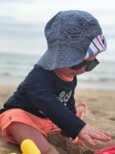 Young child playing on the beach