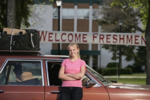 Student standing in front of car on first day of college