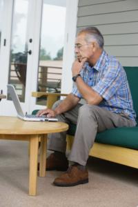 Man using laptop on porch
